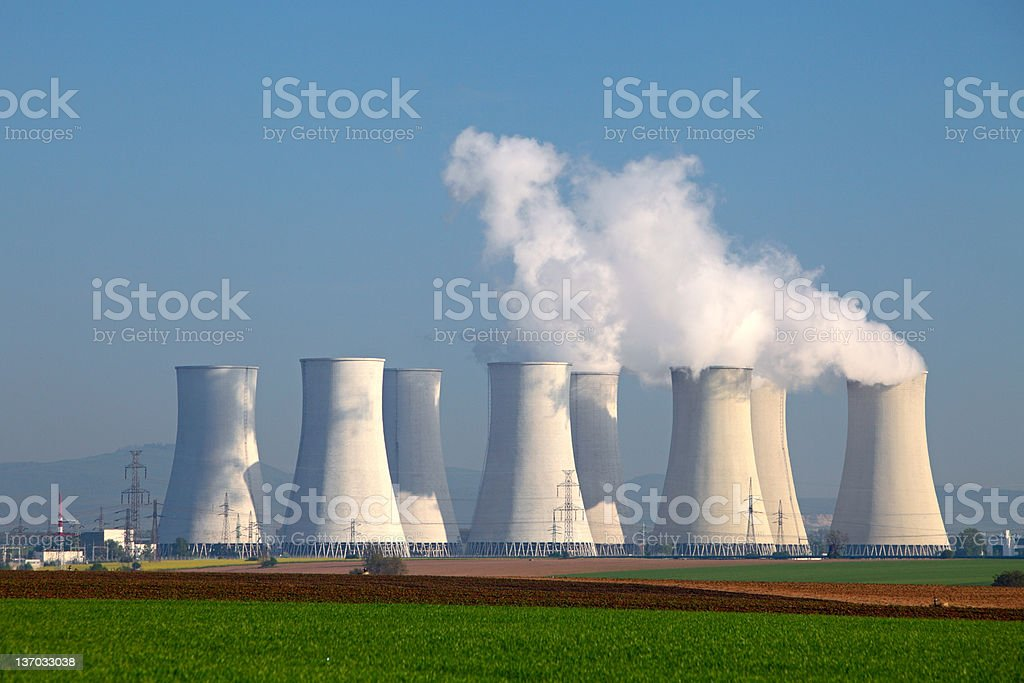 A large nuclear power plant, puffing out white smoke stock photo