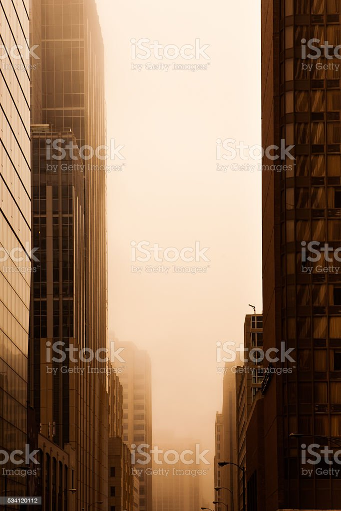 Large office buildings in fog stock photo