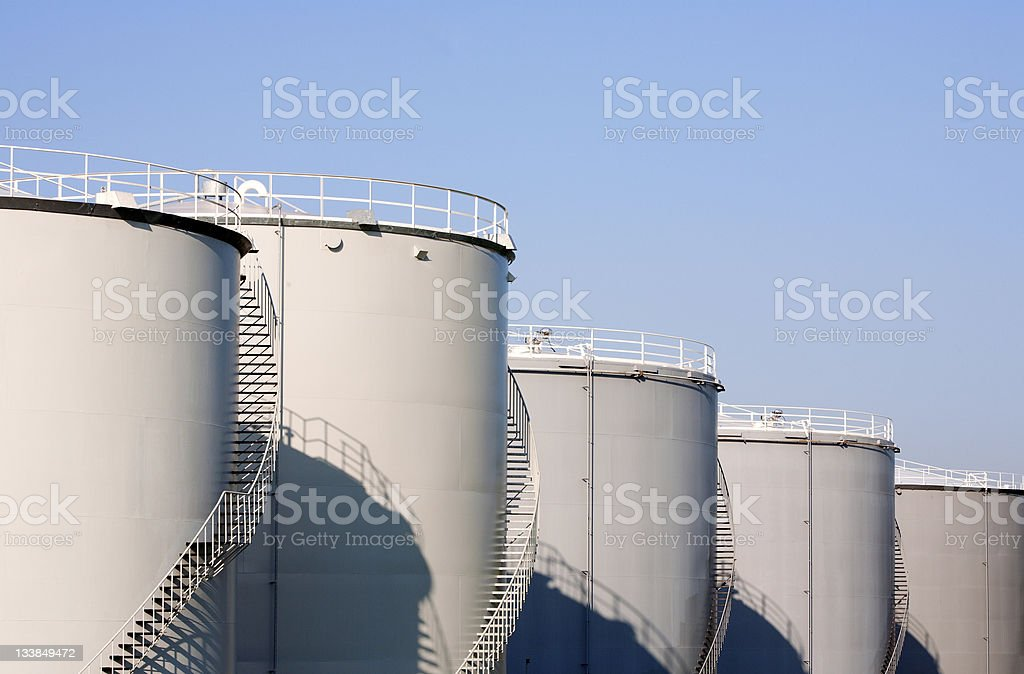 Large oil storage containers against a blue sky background stock photo