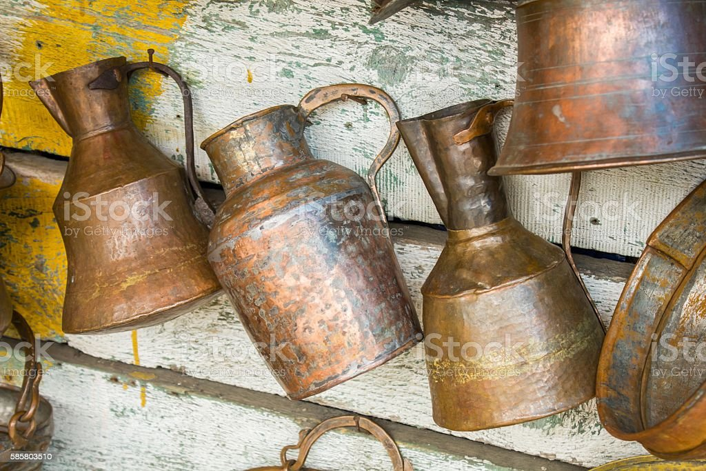 Large old antique copper cans stock photo