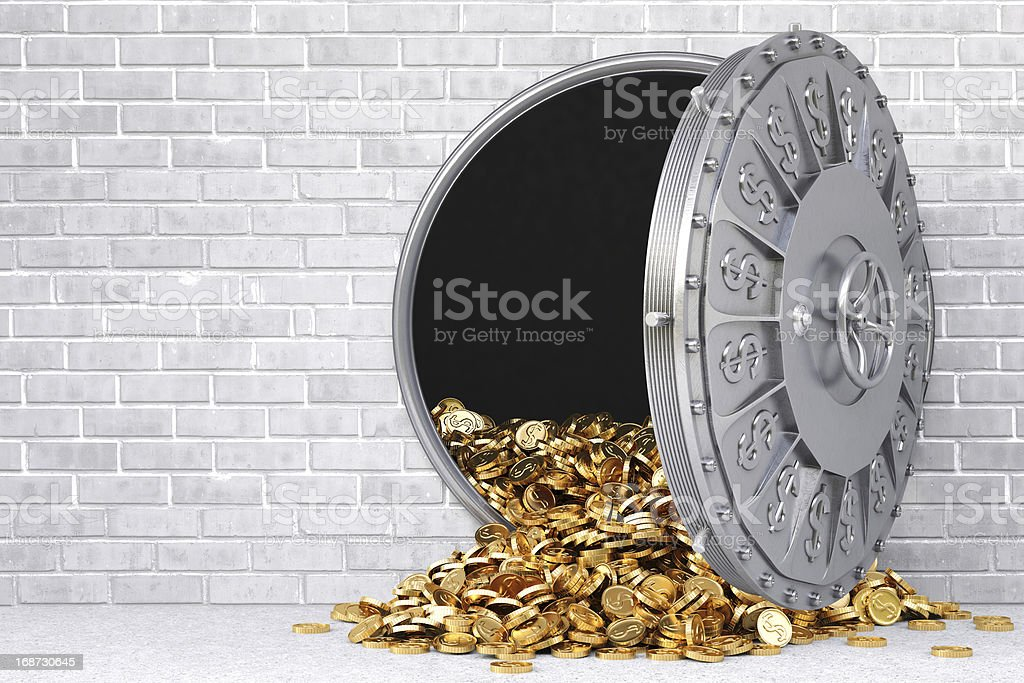A large open vault with gold spilling out stock photo