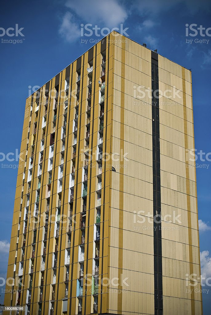Large orange block of flats or apartment in the city royalty-free stock photo