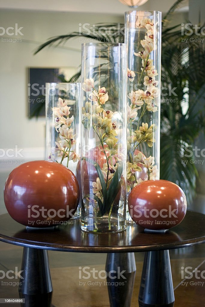 Large orchid arrangement in vases with spheres royalty-free stock photo