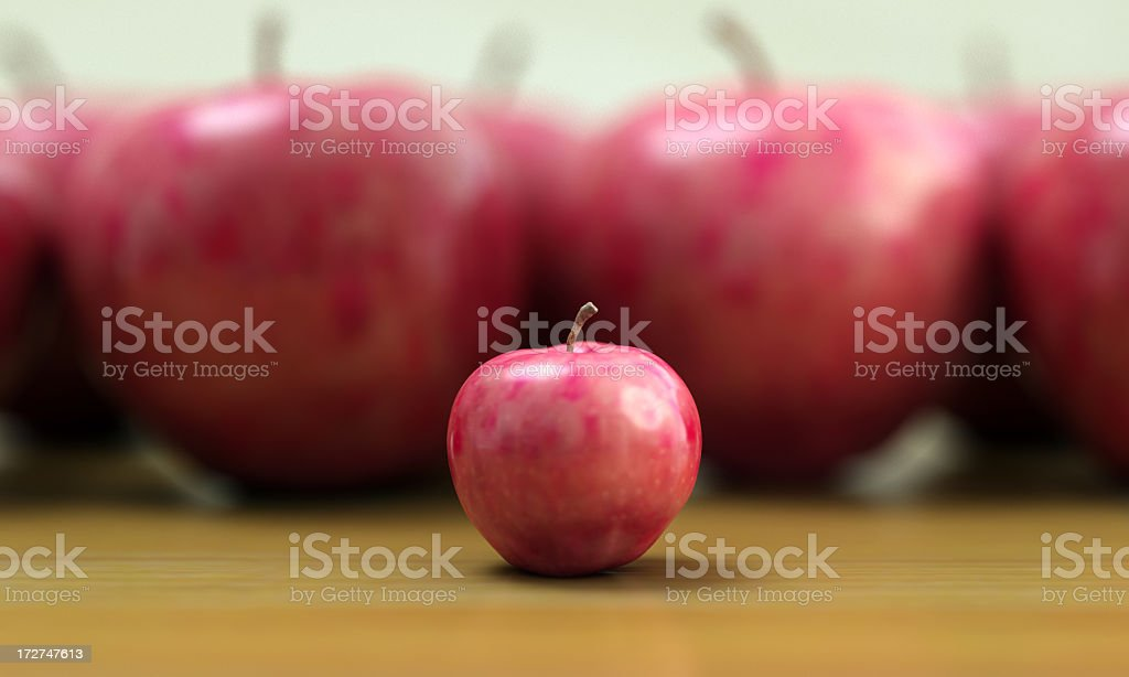 Large out of focus red apples with small in focus Apple royalty-free stock photo