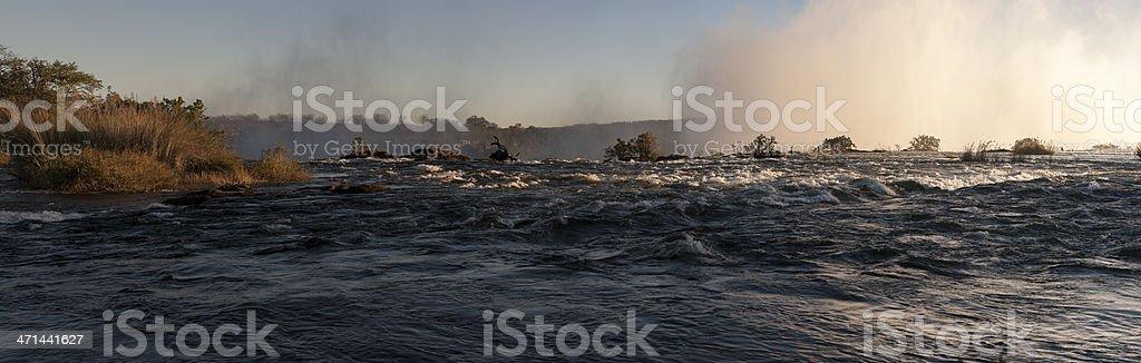 large panorama photo of zambezi river, victoria falls at sunset stock photo