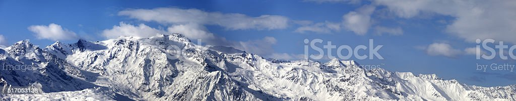 Large panoramic view on snowy mountains in nice sunny day stock photo