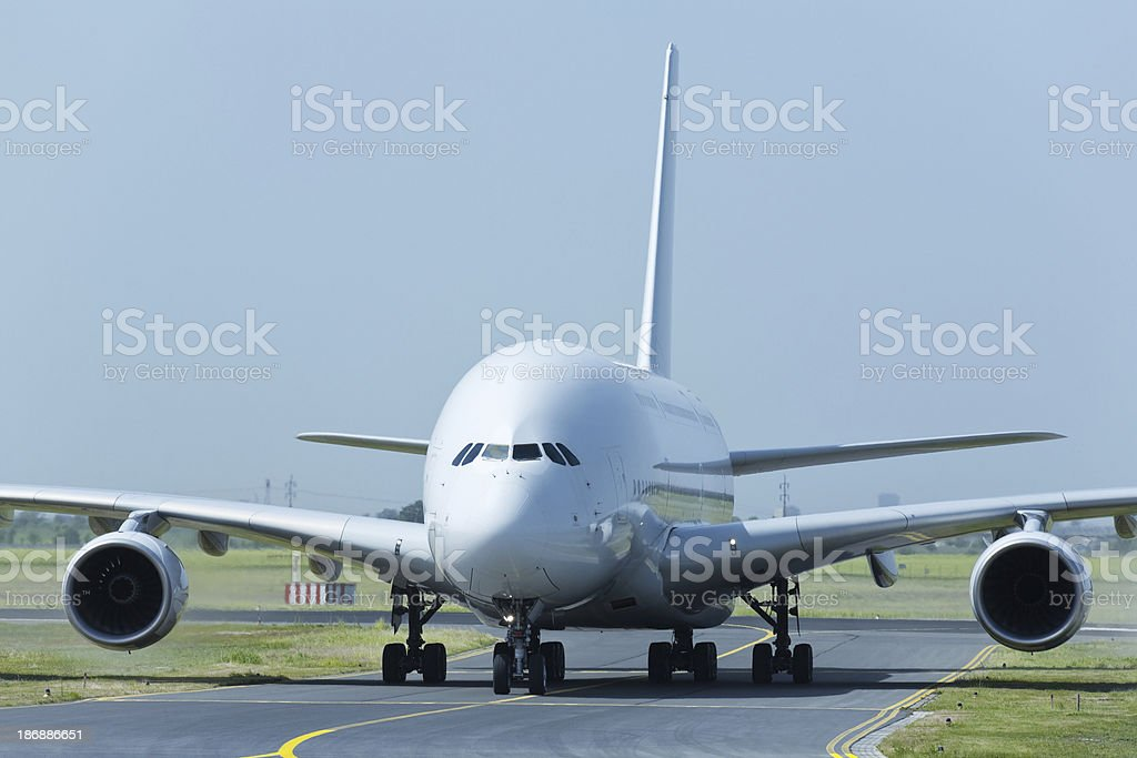 Large Passenger Jet Taxiing to Runway stock photo