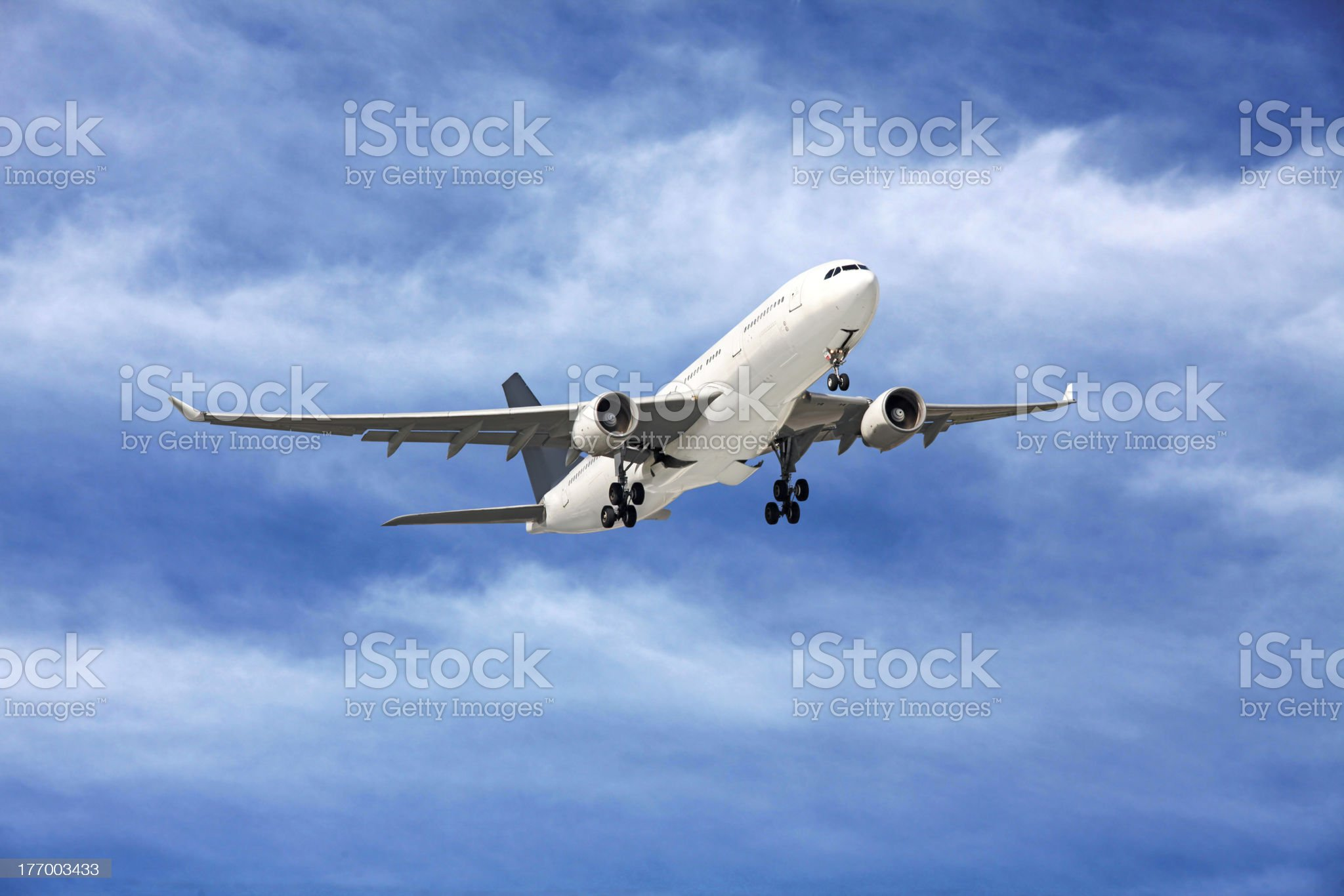 Large passenger plane flying in the blue sky royalty-free stock photo