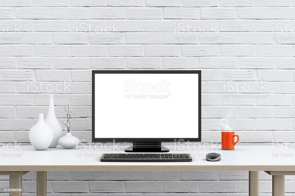 Large PC monitor in front of a brick wall stock photo