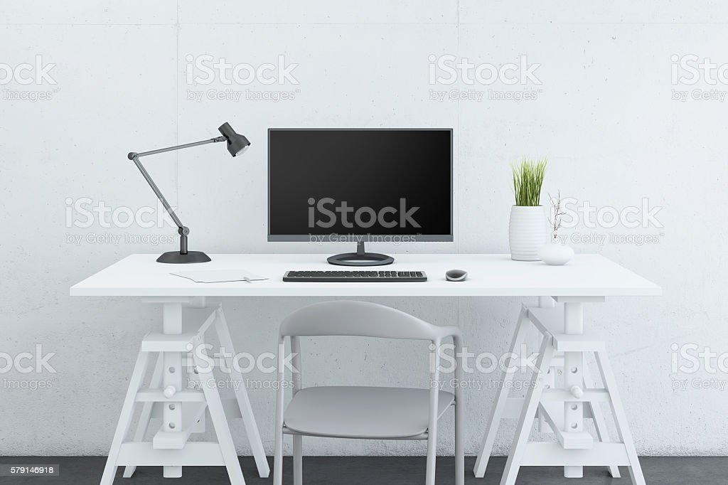 Large PC monitor in front of a concrete wall stock photo