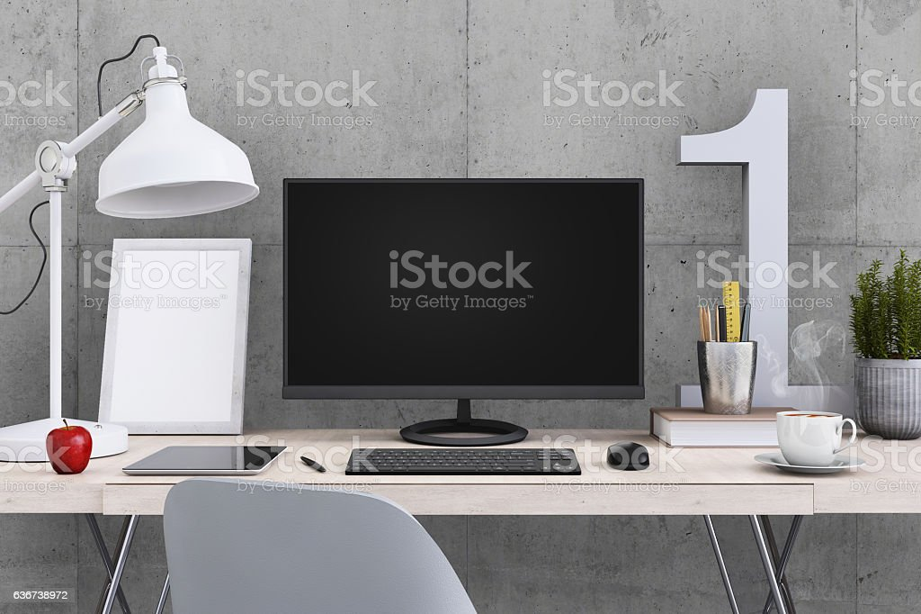 Large PC monitor on an office desk stock photo
