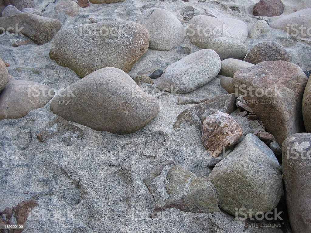 Large pebbles on a Sandy Beach royalty-free stock photo