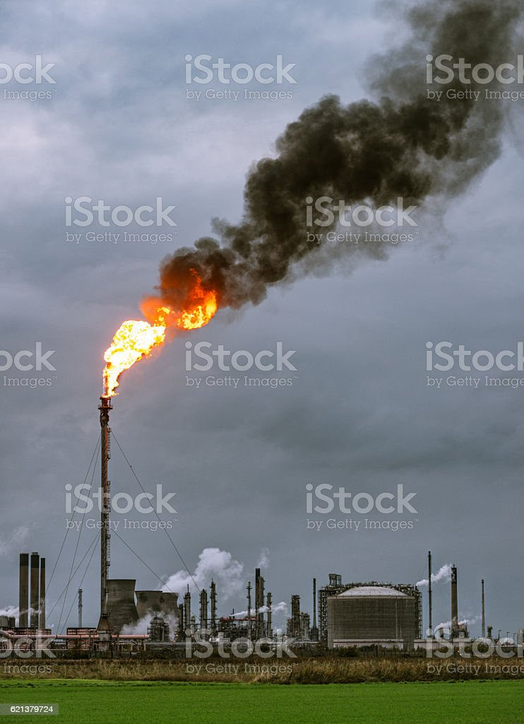 Large petrochemical flare and smoke stock photo