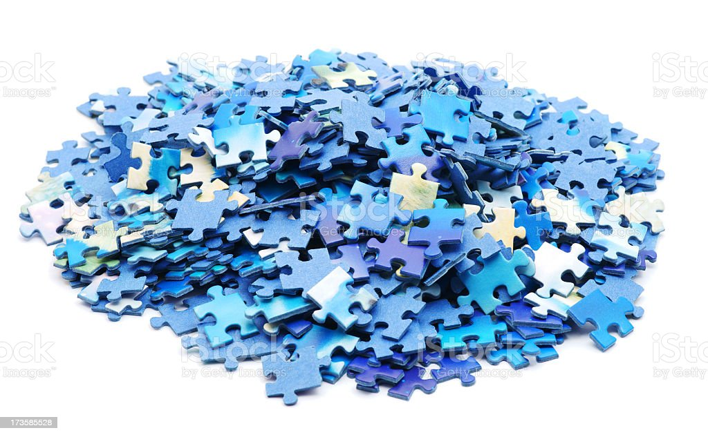 Large pile of blue hued jigsaw pieces stock photo
