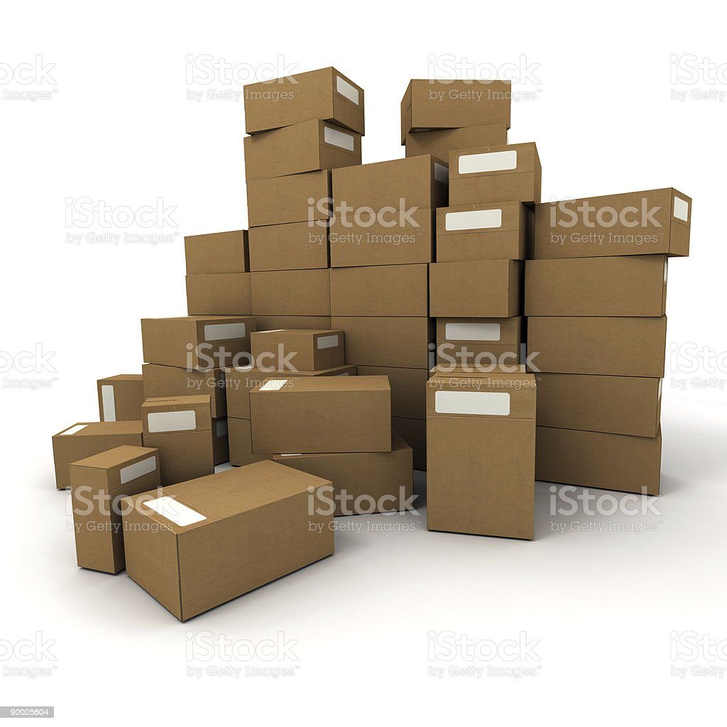 Large pile of brown packing boxes stacked and laying around stock photo
