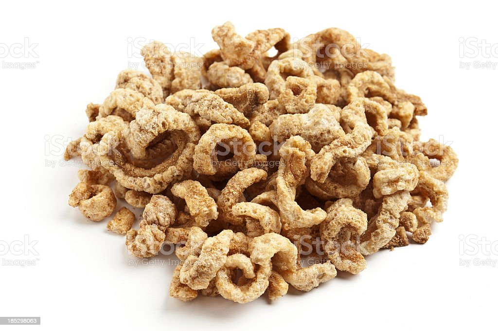 A large pile of fried pork rinds on white background. stock photo