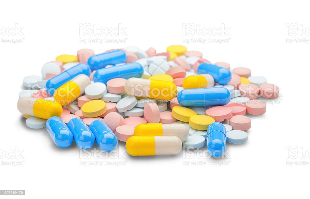 large pile of multicolored tablets and pills medically stock photo