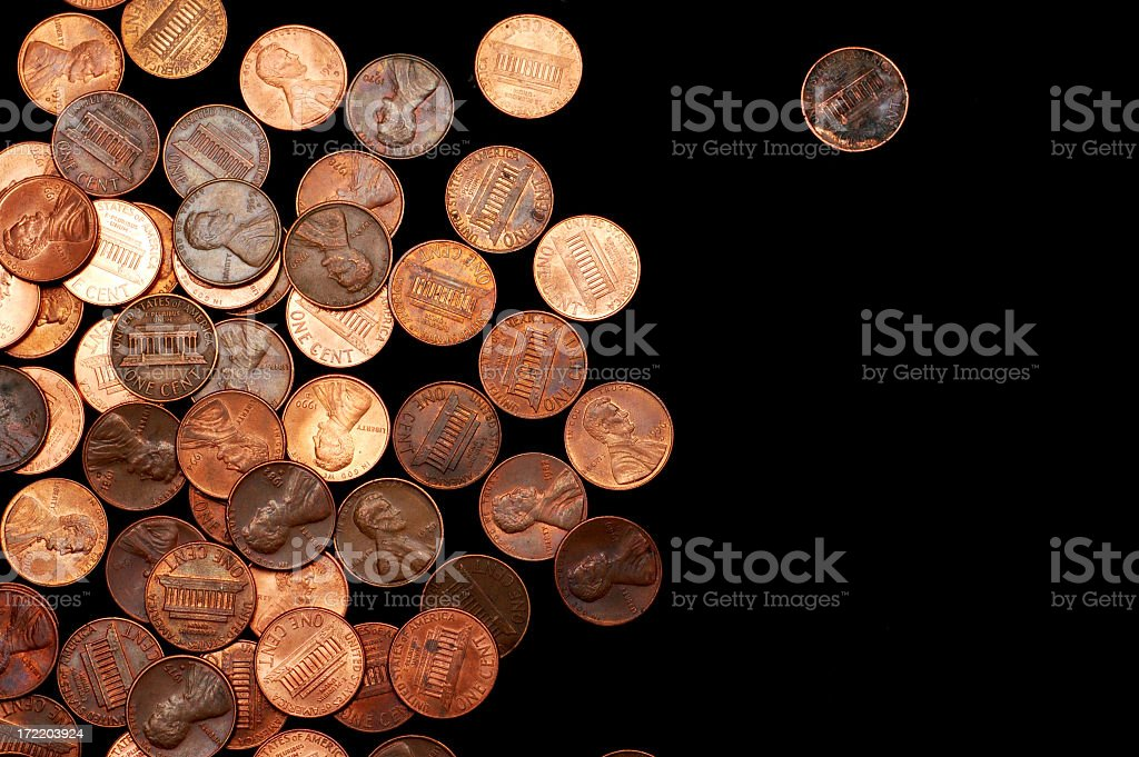 Large pile of pennies on a black background royalty-free stock photo