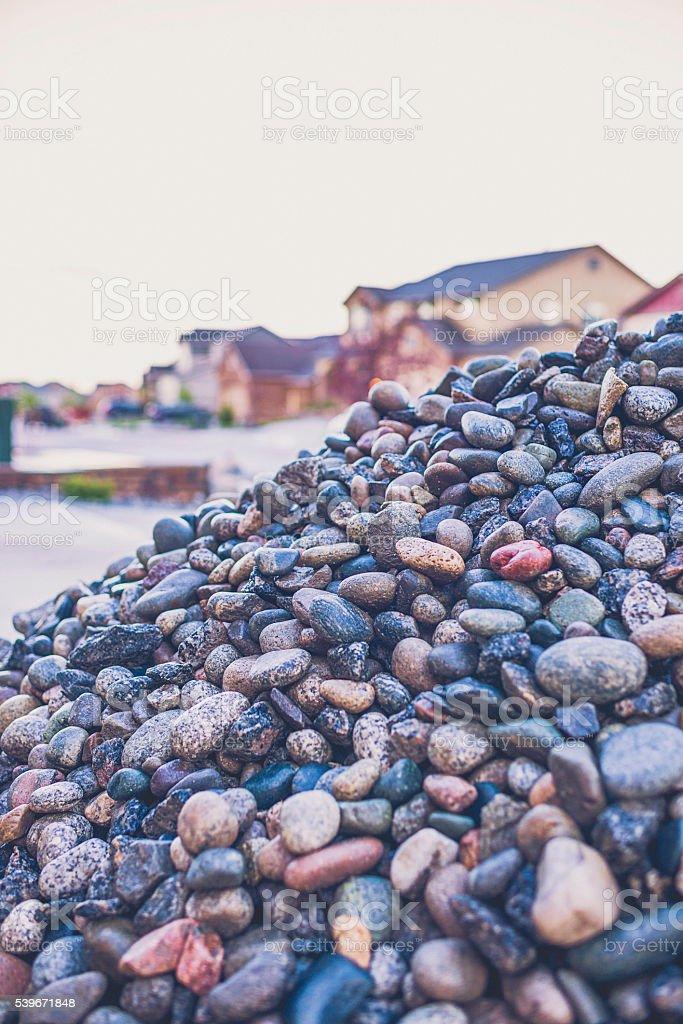 Large pile of river rocks for landscaping. Residential neighborhood. stock photo