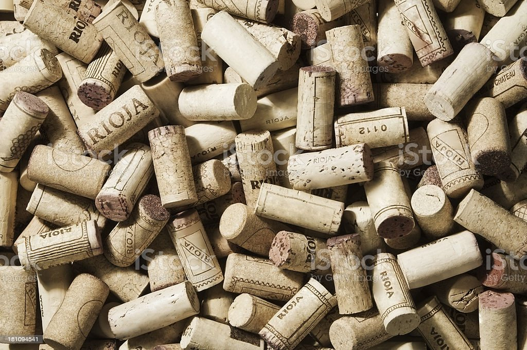 Large pile of used wine corks from various wines stock photo
