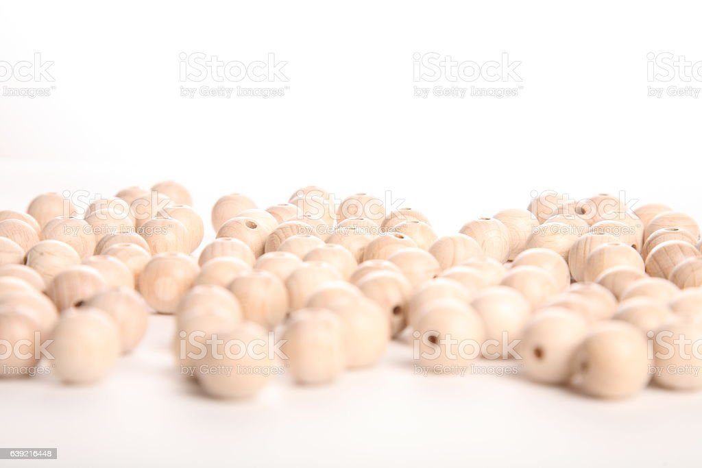 Large pile of wooden beads, speheres on white background stock photo