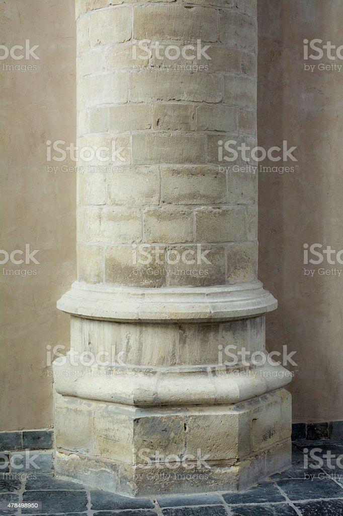 Large pillar  in old european church stock photo