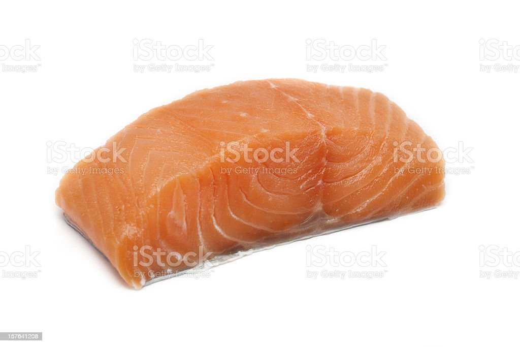 A large pink salmon fillet isolated on a white background royalty-free stock photo