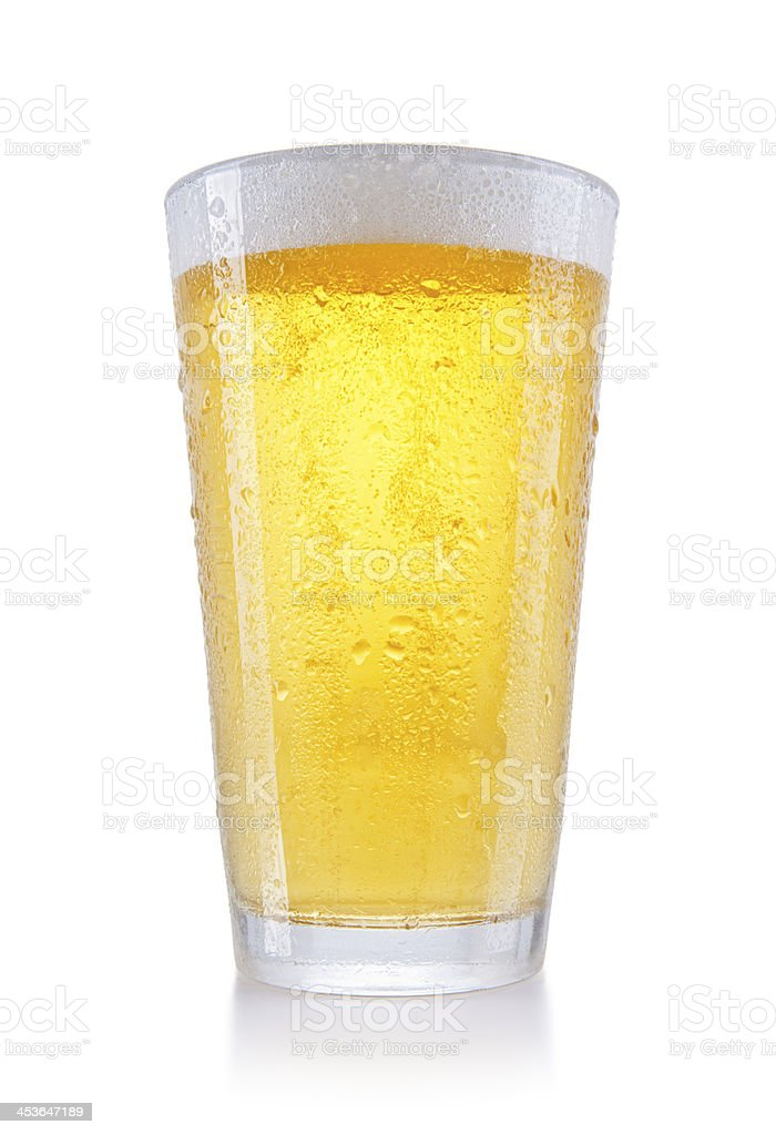 A large pint of beer in a clear glass royalty-free stock photo
