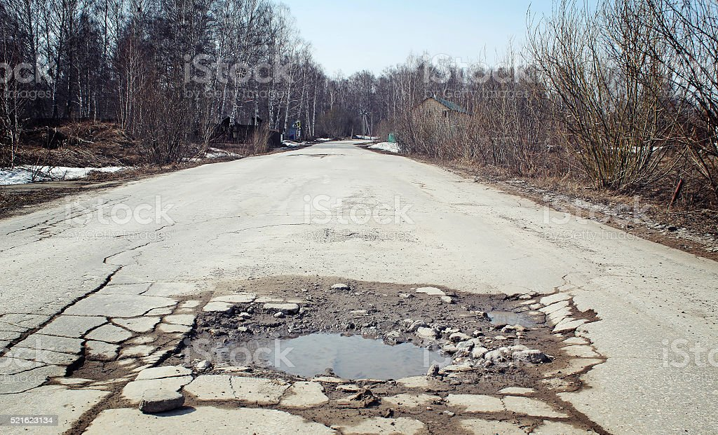 Large pit on the suburban road stock photo