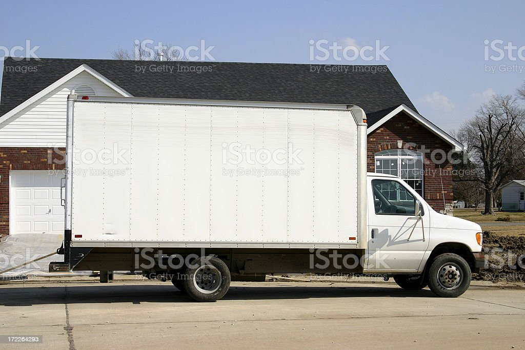 Large plain white removal van parked outside of a house  royalty-free stock photo