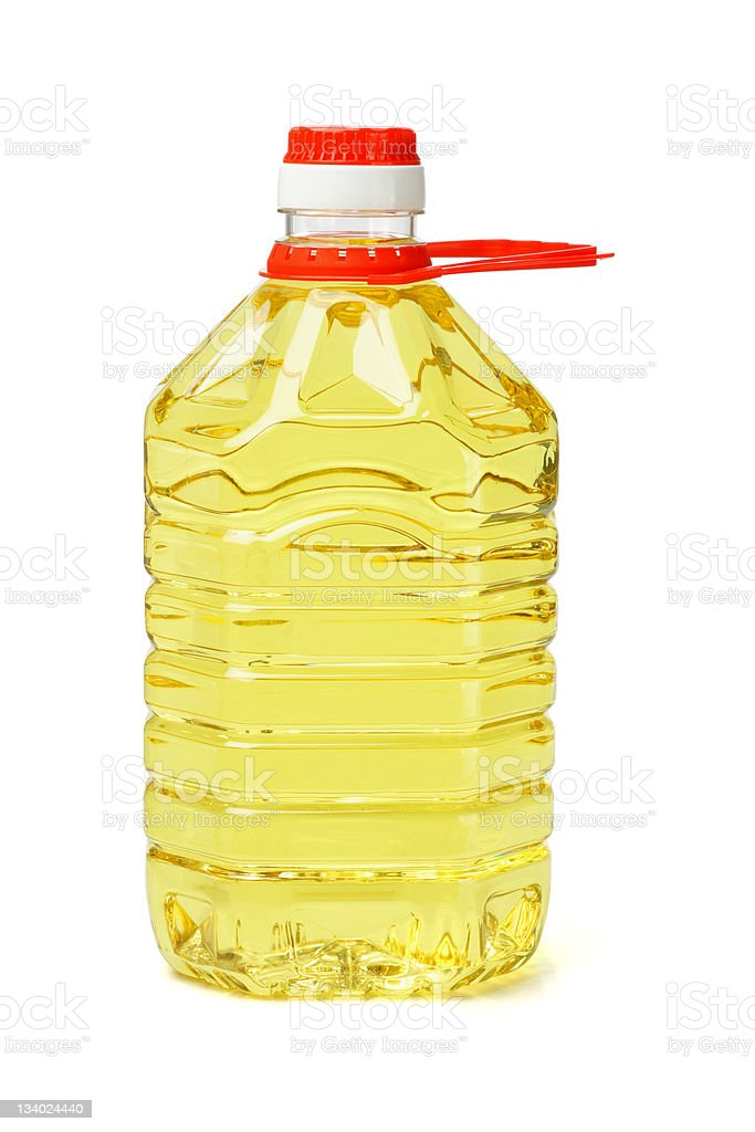 Large plastic bottle of yellow cooking oil with red lid stock photo
