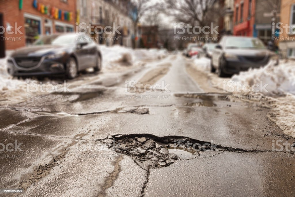Large pothole in Montreal, Canada. stock photo