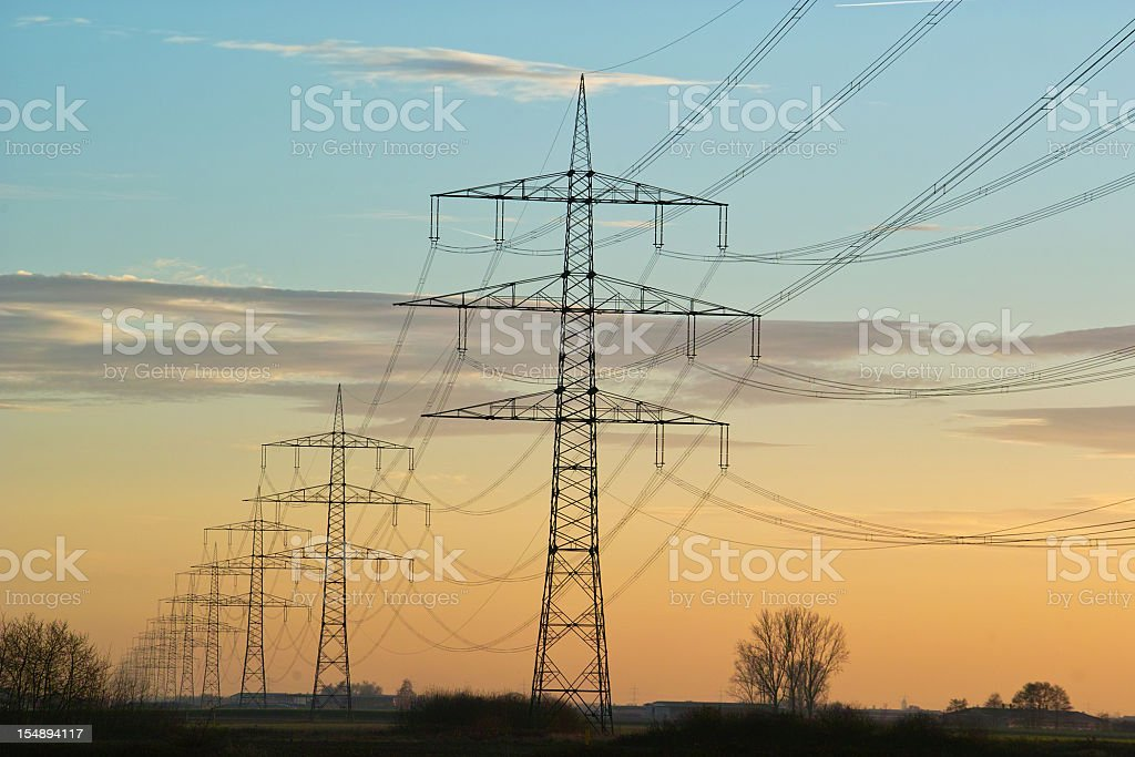 large power pylons in sunset royalty-free stock photo