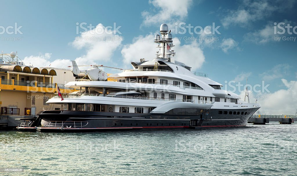 Large private motor yacht moored at the harbor stock photo