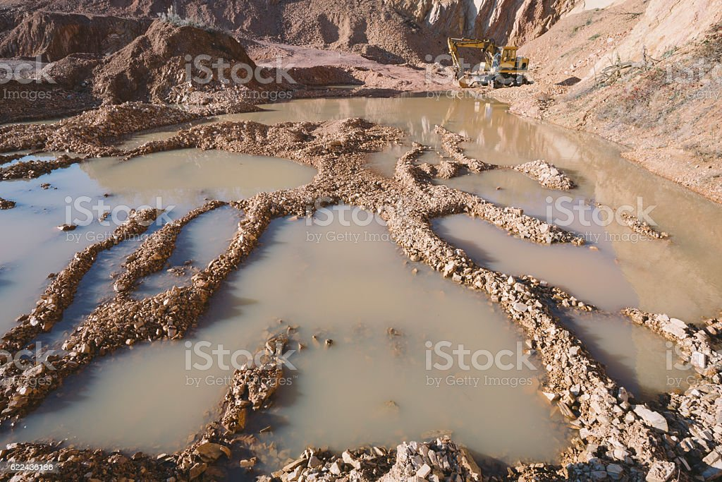 Large puddles in some stone quarry mine stock photo