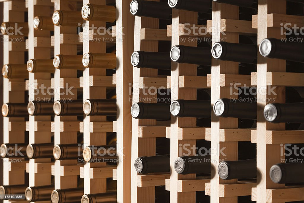 Large Quantity Bottles of Wine in Cellar Rack Hz royalty-free stock photo
