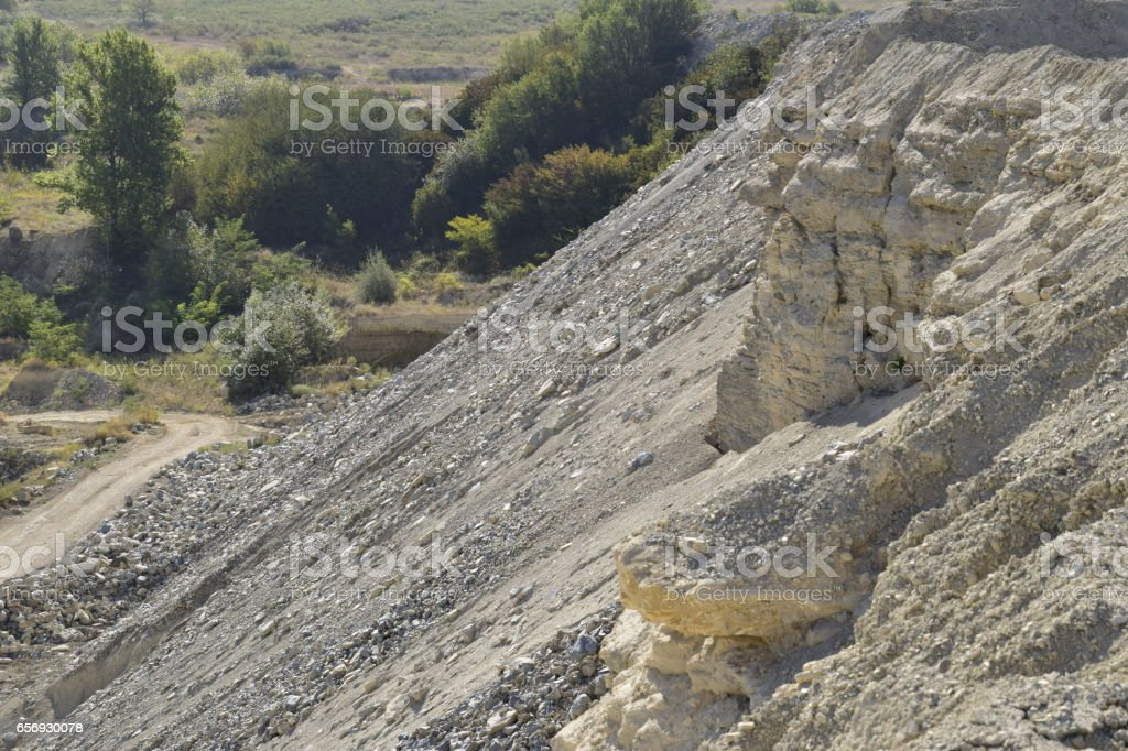 Large quarry for gravel mining, sand and clay. Mining machines and units. Mining stock photo