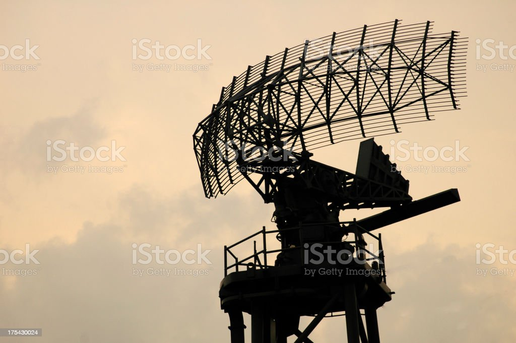 Large radar antenna against a cloudy sky stock photo