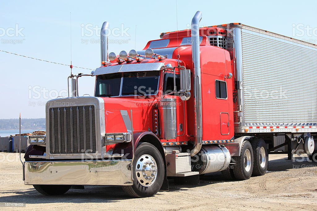 Large red and silver big rig parked in a lot royalty-free stock photo
