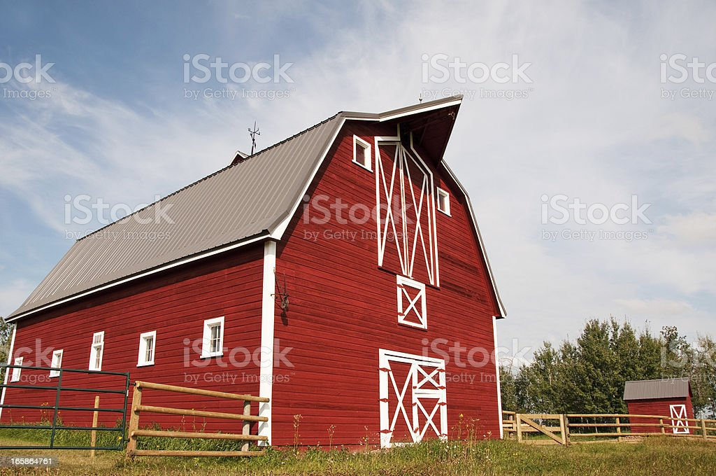Large red and white barn with a hay loft royalty-free stock photo