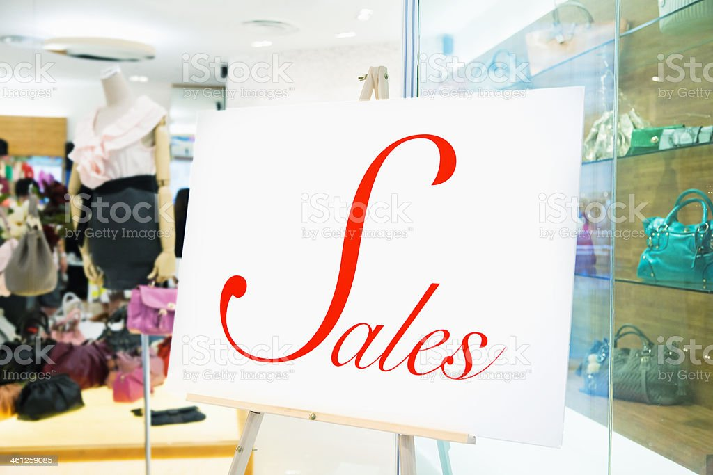 Large Red and White Sales Sign in Shopping Window, Singapore stock photo