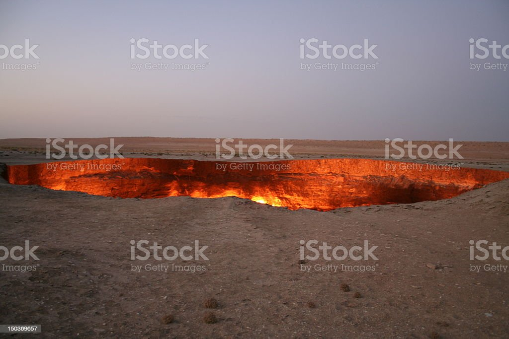 Large red hot Darvaza gas crater stock photo