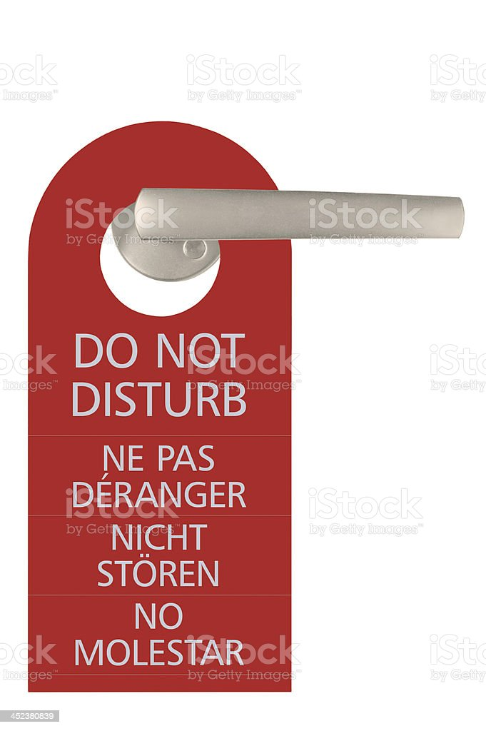 Large Red Isolated Do Not Disturb Door Handle Tag Closeup stock photo