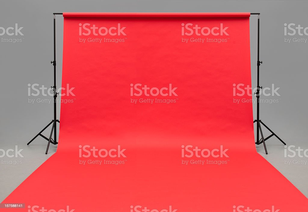Large red paper rolled onto the floor stock photo