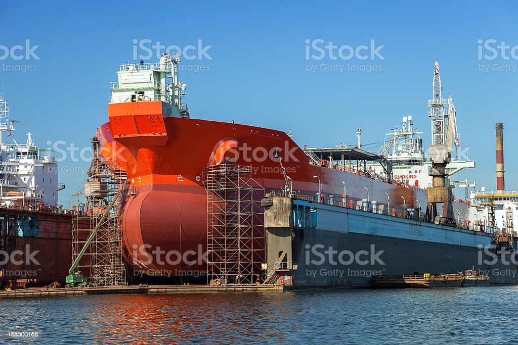 Large red tanker in the dry dock stock photo