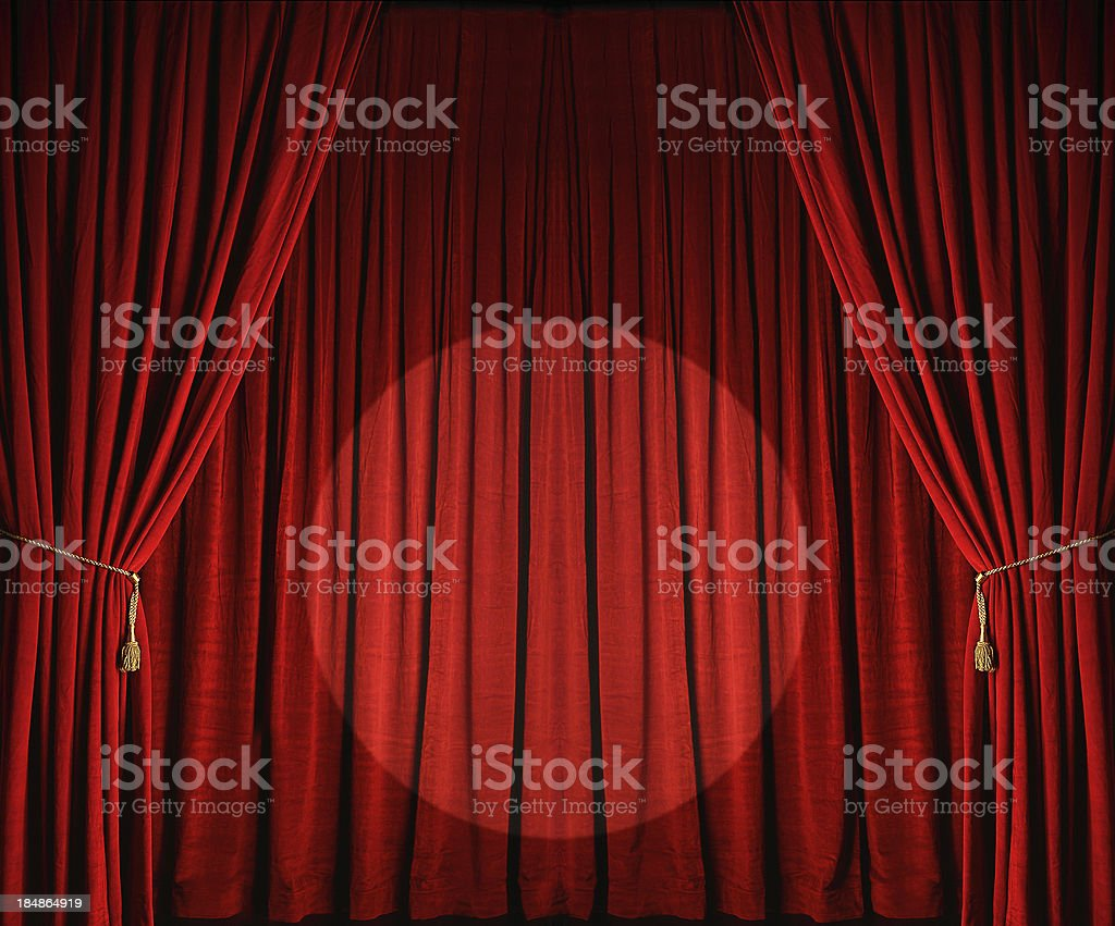 Large red theatre curtains with spotlight stock photo
