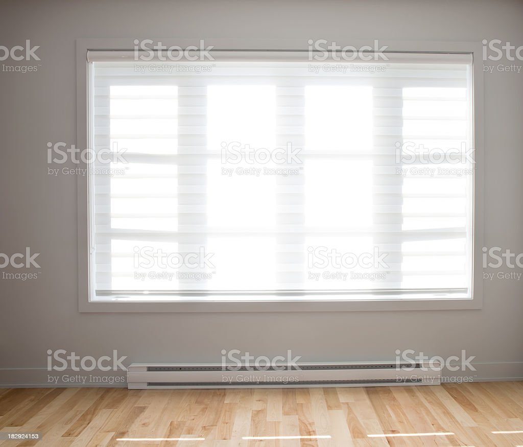 Large residential window with wooden floors stock photo