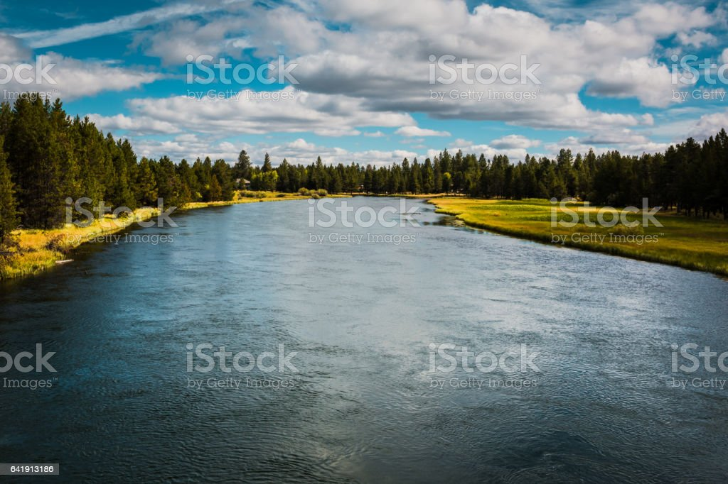 Large River with blue sky and clouds stock photo