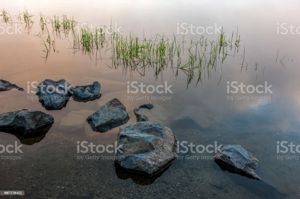 Large rocks in still water. stock photo