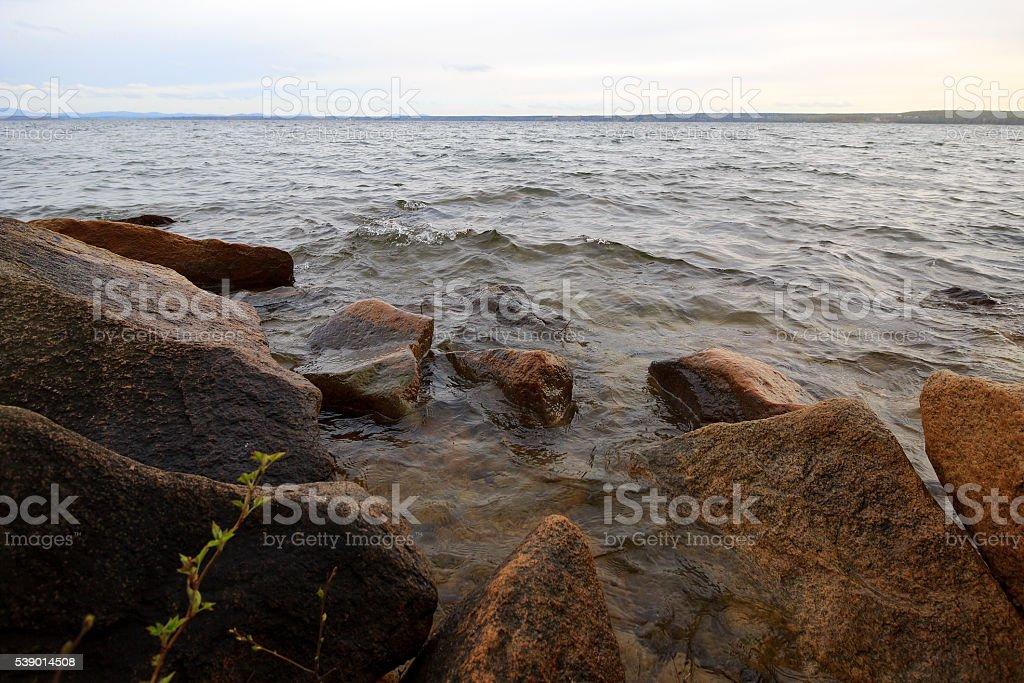 Large rocks on lake stock photo